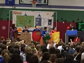 Students demonstrate the basic food groups during school-wide assembly.