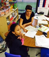 Ms. Chavez works with a 2nd grader one-on-one!