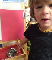 Evan sharing his art idea