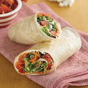 OUR NEW WRAP WITH TOMATOES AND SALAD
