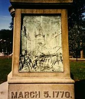 A carved picture on stone of the Boston Massacre