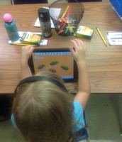 Kindergartners in Mrs. Criger's class are loving the app AlphaTots to practice their ABC's!