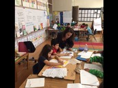 Lauren helping students with their writing