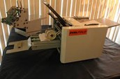 Miniature paper folding machine