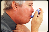 This is someone using an inhaler
