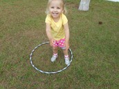 Isabelle is trying so hard to hula hoop
