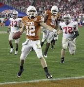 quarterback Colt McCoy celebrates his third-quarter touchdown run against Ohio State