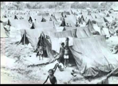 A picture of a refuge camp, This relates to the war because people were spread throughout these  camps.