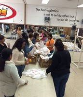 Parents from ESL classes and general volunteers help pack for Food Distribution