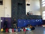 Climbing wall lesson in gym