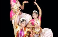 Some people performing Bharathanatym
