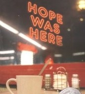 Having a nice cup of coffee.