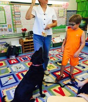 Second Grader Kai helps introduce Lucy to her new class
