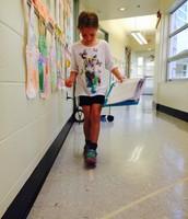 Grace measuring in kid feet!