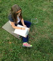 Taking field notes in the front yard