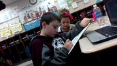 Jack and Makayla working and reading.