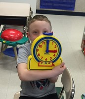 Practicing telling time to the hour at math work stations!