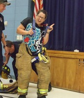When a firefighter uniform is too tight to zip, just shake it off with a little dance!