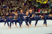 Video of senior women on floor, tumbling and tramp.