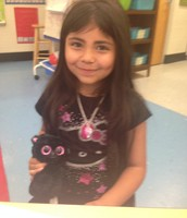 Isabella and her stuffed friend match on Spirit Day!