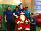 Our wonderful cafe staff with Santa Clay