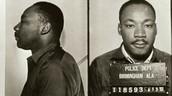 MLK taking a famous mug shot.