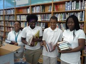 Students celebrate arrival of new books!