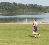 Alex May finishing at a Cross Country meet.