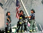 Firemen rasing the flag after the Twin Towers collapsed