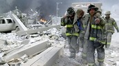 Firefighters in the wreckage