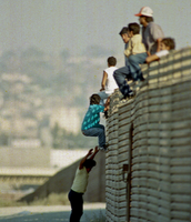Immigrants Jumping Over Fences