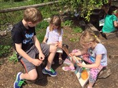 Reading with buddies in the garden
