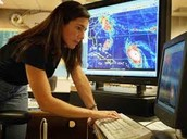 Meteorologist observing at coastal weather radars