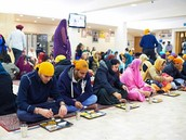 Group of Sikhs Dining in a Gurdawa