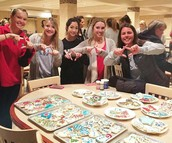 New Members Decorating Cookies for Make-A-Wish