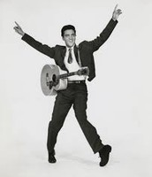 Elvis and his Guitar.