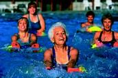 Seniors enjoying our salt-water pools in a Water Aerobics Class