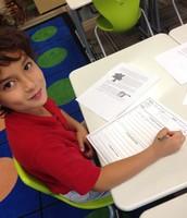 Kai working hard on his         3-2-1 Reading Reflection