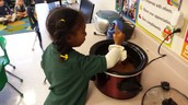 Brielle continuing to stir our delicious treat!