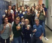 Happy students with cookies