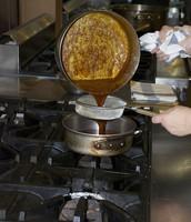 Straining the finished Caramel Sauce.