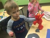 Alex feeds Elmo a bear :-)