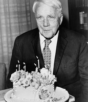 Robert Frost with a fancy cake.