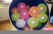Balloons in a Chair...and Oh! Is that a person we see?