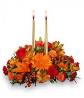 Table Centerpiece with roses, sunflowers, berries, and candles