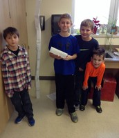 Luke, Tanner, and 2nd Grade Buddies make a paper tower.