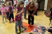 Students receiving their new shoes!