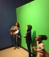 Ms. Freeman's students (and chaperone) on the green screen
