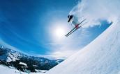 A Man Skiing off a Mountain