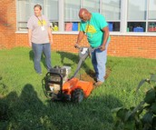 Ms. Tracy and Mr. Wells share tilling tips with MTE students and staff